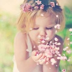 To behold the beauty and delicacy of nature together in both child and flower is breathtaking. Ivet H. P. (c)