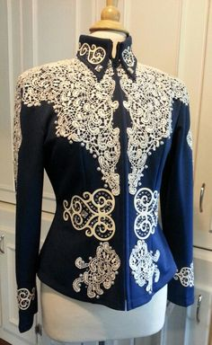 Western showmanship outfit size 6-8 has over 600 Swarovski crystals and hundreds of pearls. Slacks are size 30 (6/8). I will hem for you. $1200 for set.