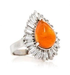 A 14 Karat #White #Gold, Sunstone and #Diamond Ring, contains one pear shape cabochon cut #sunstone weighing approximately 6.19 carats and 34 tapered baguette cut diamonds weighing approximately 2.28 carats total.