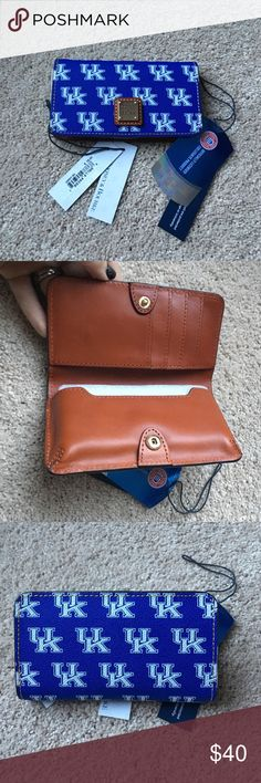 BNWT Dooney & Bourke UK IPhone Wallet Brand New with tags University of Kentucky Dooney & Bourke Wallet. Never used. Fits IPhone 6 model. I use a mophie case so my phone is too big to use with it. This is perfect for any U.K. fan looking for a easy way to store your phone and credit cards!!! Has 4 card slots and a flap to store cash. The iPhone slot can be used to hold cash or additional cards as well. Dooney & Bourke Bags Wallets
