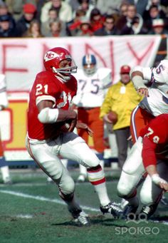 Mike Garrett--won the 1965 Heisman Trophy as a tailback for the USC Trojans.  He was a two-time AFL All-Star in 1966 and 1967. Garrett played in the first ever AFL-NFL World Championship Game (Super Bowl I) with the Chiefs after the 1966 season. He contributed 17 rushing yards, 3 receptions for 28 yards, and 2 kickoff returns for 43 yards in their Super Bowl I loss. Garrett won a World Championship ring with the Chiefs in the last AFL-NFL World Championship Game (Super Bowl IV)