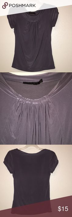 Beautiful gray blouse The limited XS blouse.  Dark gray.  Really soft and comfortable.  94% polyester 6%. Spandex. The Limited Tops Blouses