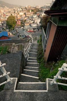 Steep stairs in Nagasaki, Japan Japan Travel Destinations Family Friendly Kids Vacation Asia Aesthetic Japan, City Aesthetic, Casa Anime, Japan Street, Nagasaki, Scenery Wallpaper, Anime Scenery, Urban Landscape, Japan Travel