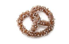 This pretzel works up easily with herringbone tubes. Add salt to your pretzel with silver-lined crystals from the June 2005 issue