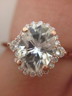 Rose Gold Engagement ring, oval, halo. Love the thin band and large stone!