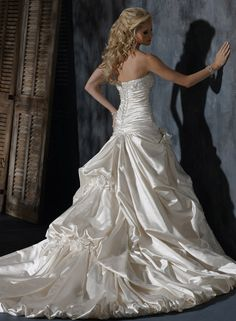 Back of Ambrosia gown by Maggie Sottero shown in alabaster.
