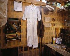 Grafter's coverall covered in graphite scribblings of cultural bee lore, leather work apron, gloves, bee veils and library. J. Morgan Puett. Grafter's Shack installation. WaveHill. 2002. Curator: Jennifer McGregor