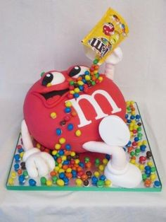 3d M&M gravity defying cake. www.cakedinit.co.uk