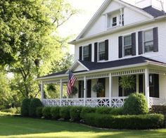 Classic White Farmhouse with Expansive Front Porch