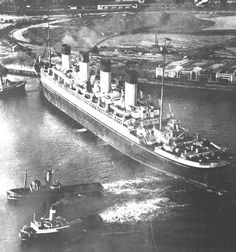 RMS Olympic 1935 going to the breakers..Retired at Southampton after 24 years service & scrapped. Superstructure dismantled at Jarrow, England, and the hull at Inverkeithing, Scotland