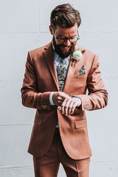 Groom In Orange Coral Wedding Suit | By Mollie McAusland Photography | Cornwall Wedding | Intimate Wedding | Small Wedding | Garden Wedding | Outdoor Wedding | Pink Wedding Colour Theme | Groom Wedding Suit | Colourful Wedding Suit | Fitted Wedding Suit | Fitted Suit | Colourful Suit | Grooms Wedding Outfit | Buttonhole Fitted Wedding Suits, Fitted Suit, Pink Wedding Colour Theme, Wedding Venues Cornwall, Cornish Wedding, Morning Suits, White Dahlias, Groomsmen Suits, Small Intimate Wedding