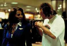 Still of Quentin Tarantino and Pam Grier in Jackie Brown (1997) http://www.movpins.com/dHQwMTE5Mzk2/jackie-brown-(1997)/still-420593408