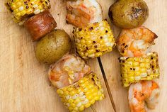 BBQ shrimp skewers w/corn on the cob & golden potatoes. (I would substitute the potatoes for red potatoes)