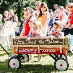 Wedding. Babies in wagon flower kids