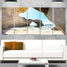 Designart 'Portugal Coast with Amazing Caves' Landscape Glossy Metal Wall Art