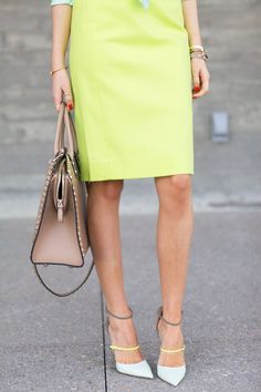 Forget the winter-throwback temperatures here in NYC; I'm reveling in spring colors, like this mint top (you can just see it) and lime skirt combo.