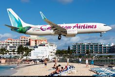 A Caribbean Airlines B737 Flying over Maho Beach, about to land at St. Maarten. Manny Gonzalez.