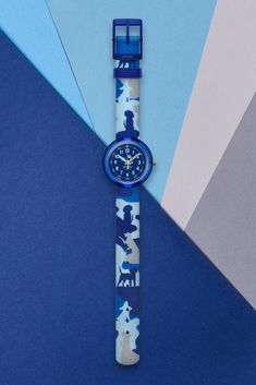 WOOFLAGE (ZFPNP058) has a cool look with its light blue and dark blue colour scheme, and that's not the only distinctive feature of this kids' wrist watch. Its canine design features cute illustrated dogs on the machine-washable textile strap, making it a great gift for animal lovers. This blue dog wrist watch for kids also has a digital printed dial that is both shock and water resistant, as well as being BPA-free for complete protection. Dark Blue Color, Light Blue, Blue Color Schemes, Blue Dog, Rolex Watches, Bracelet Watch, How To Look Better, Great Gifts, Lovers