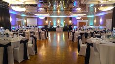 This wedding reception of 245 guests was held in our Grand Ballroom. The layout included a full stage for a live band!