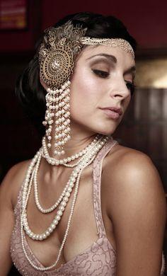 Pearls, beautiful styling. Roaring '20s chic.