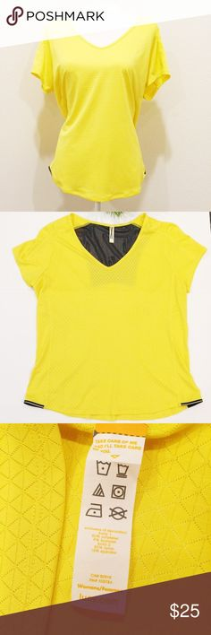 LUCY Athletic Mesh Top Golden Desert XL LUCY Show Up Top with sheer nylon back in black.  A body skimming top with breathable mesh fabrics allows for ventilation in a sleek silhouette that won't get in the way of your run.  Gently used, excellent condition.  Label marked out so it cannot be returned in stores.    Color:  Golden Desert & Black Relaxed fit Reflectivity at side hem for 360 visibility Back mesh panel for venting 92% Polyester, 8% Lycra® Spandex Style: 0A33BC_SALE Lucy Tops