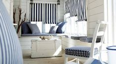 Prestigious Textiles - Maritime Fabric Collection - Navy blue and white striped roman blinds, and navy blue and white chequered seating pads for a maritime house setting Decor, House Design, Interior, Home, Beach House Decor, White Decor, House Styles, Interior Design, Nautical Home