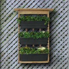 Vertical Living Wall Planter. www.teeliesfairygarden.com . . . This vertical living wall planter would look absolutely dazzling in your garden! The uniqueness is just amazing! #fairyplanter