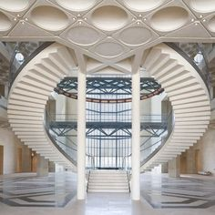 The museum Islamic Art in Qatar by I. M. Pei. The building has a grand double staircase with stairs carved on the bottom side of it to give the illusion of an upside down staircase.