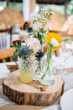 Rustic barn wedding centrepiece with mixed bud vases on wood rounds | Dream Bella Photography
