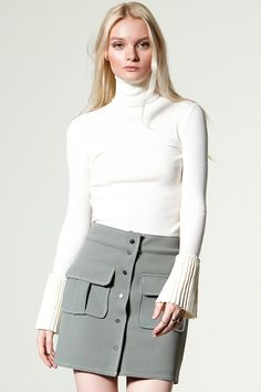 Lavi Pleated Sleeve High Neck Top Discover the latest fashion trends online at storets.com