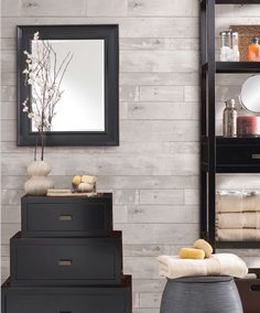 I love this weathered wood panelling textured wallpaper from sears. It is hung horizontally and would look great in a bathroom or bedroom. Link (Canada): http://www.sears.ca/product/weathered-wood-panel-textured-wall-covering/630-000045476-347-20131