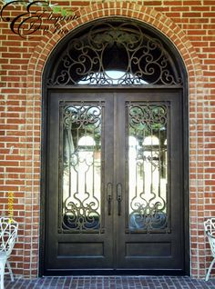Beautiful Custom Wrought Iron Door With Attached Full Arch Transom.