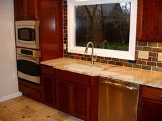 Shaker Heights OH Kitchen Remodel: Kraftmaid Cherry Cabinets, The Tile Shop Sandlewood travertine tile flooring, granite, Copper Rust slate backsplash & floor insets, GE stainless steel appliances