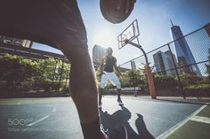 Two street basketball players playing hard on the court by kato84