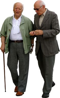 two old men walking down the street chatting to each other