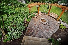 circular pergola - Saw something very similar to this at the stone store.  It was so pretty with hanging plants in between the posts. Doesn't look all that complicated either.