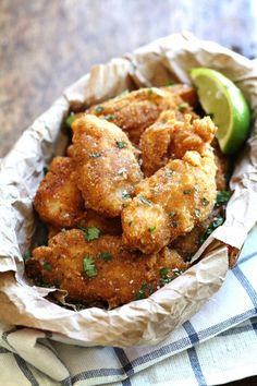 Crispy Fish for spicy fish tacos - beer-battered and served with cilantro, lime, and a homemade jalapeño sauce. So good! | pinchofyum.com