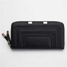 "Material  			 				 PU Leather  		 		 			 				 Color  			 				 Gray,Pink,Black  		 		 			 				 Lining  			 				 Polyester lining  		 		 			 				 Length  			 				 20cm(7.87"")   		 		 			 				 Height  			 				 10.5cm(4.13"")  		 		 			 				 Width  			 				 2.5cm(0.98"")  		 		 			 				 Interior  			 				 8 Card Slots Inside, 3 Pocket and 1 Zipper Pocket   		 		 			 				 Closure  			 				 Zipper  		 	   	 Package Include: 	1 * Wallet"