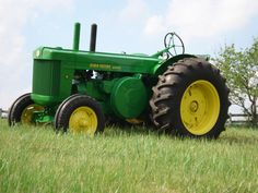 """John Deere two cylinder model R. The first diesel by John Deere, and the first with live PTO. Built from 1949-1954 at the Waterloo plant. The 416cid, 5.750"""" bore x 8.000"""" stroke, 16:1 compression ratio two cylinder engine generated 43.15 drawbar horsepower and 48.58 belt horsepower at 1000 RPMs. All 21,293 built were standard tread and were pony start. There were Rice Specials built, but the numbers on how many are sketchy."""