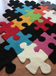Puzzle Pieces Rug!  Great for a kids playroom!  Could probably do this with carpet remnants on the cheap! And if one puzzle piece gets ruined, take it up and replace it with another instead of buying a whole new rug. So smart!