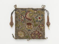Purse Place of origin: Great Britain, UK  Date: 1600-1650 Materials and Techniques: Linen, silk, silver & silver-gilt threads, silk thread; hand sewn, hand embroidered, hand plaited Museum number: 555-1893 | V&A