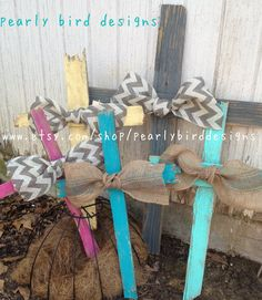 Rugged distressed cross with bow- burlap or chevron bow. Has bracket to hang on wall