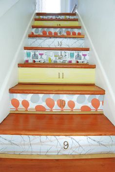 Eclectic staircase...I would have never thought of decorating stairs!