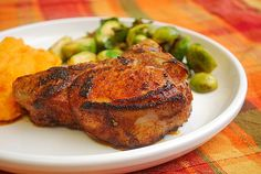 Buttermilk Brined BBQ Rubbed Pork Chops by ItsJoelen -- 4 tbs lemon juice instead of zest, halve the salt in spice rub.  For 1 inch thick chops: grill, then bake @ 300 for 25 minutes