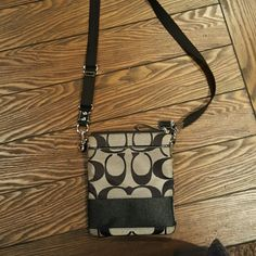 Coach cross body purse Black & tan! Coach Bags Crossbody Bags - I have this same bag - perfect for when I'm onsite working a conference and running around.