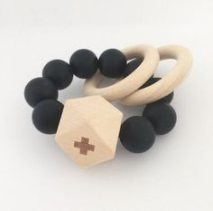 Titan wood teether from Dove + Dovelet is handmade  and safe for babies to chew on. Elegant modern design.