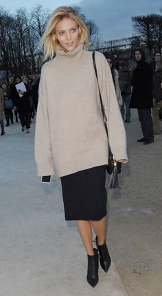When Anja Rubik wasn't busy stomping the runways during Paris Fashion Week, she was seen showing off her personal style in an oversized Celine turtleneck sweater, modern knee-length skirt and ankle booties.Photo: WENN.com