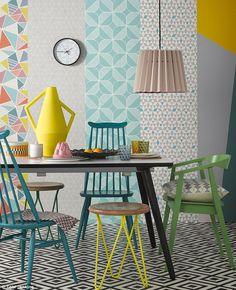 Love the mismatched chairs and colors, though the garish wallpaper can definitely go Glass Dining Table, Interior, Home Decor, Floral Accent Chairs, Ercol Dining Chairs, Fire Pit Table And Chairs, Interior Design, Ercol Furniture, Traditional Dining Chairs