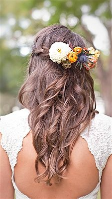 For an outdoor wedding, your hair should have a romantic and almost rustic touch. Beautiful curls and boho braids lend a whimsical vibe, while tucking blooms in your hair completes the garden look.