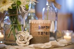 I love the jar vases, the hessian covered candle holder, the simple flowers and the book roses.